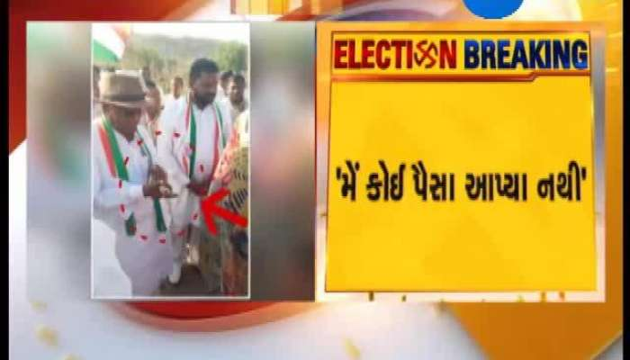 Panchmahal V.K.Khant's Photo Of Giving Money Goes Viral