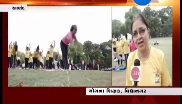People and Children Practice Yoga Ahead of World Yoga Day