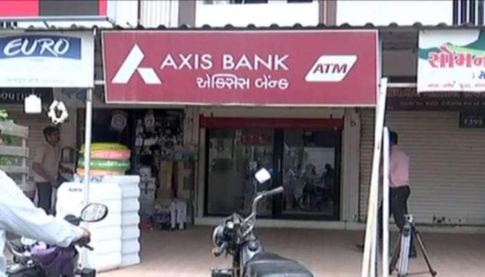 અડધી રાત્રે લૂંટાયું  Axis બેંકનું ATM, 11.50 લાખની ચોરીથી રાજકોટમાં ખળભળાટ