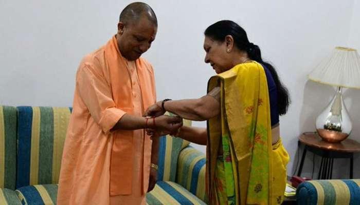 રાજ્યપાલ આનંદીબેને CM યોગીને બાંધી રાખડી, તિરંગો પણ ફરકાવ્યો