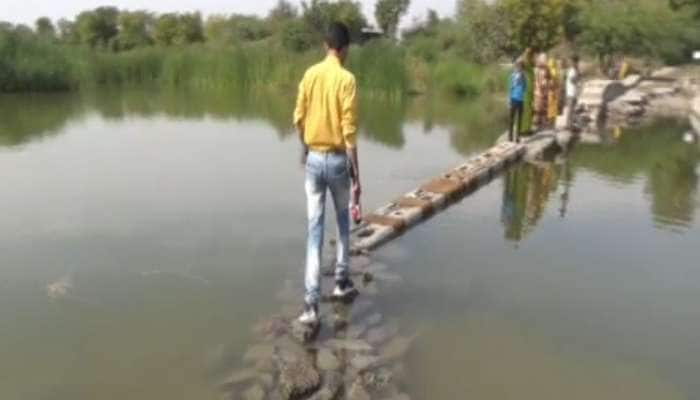 આ છે ગુજરાતનો વિકાસ? ગામલોકોએ ઘરે જવા કેડ કેડ સમા પાણીમાં ઉતરવું પડે છે, ચૂંટણીનો કર્યો બહિષ્કાર